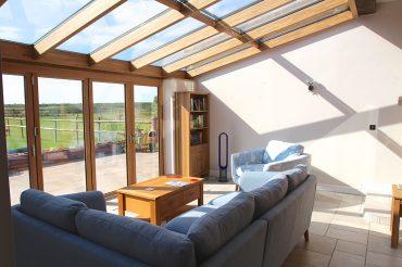 Solid Oak/Aluminium Solarlux bifold and wintergarden glass roof