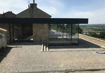Glass Box Extension with cero sliding doors