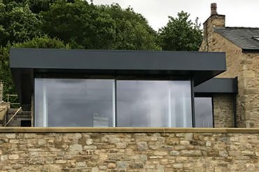Glass box style extension with Cero slim-profile sliding doors