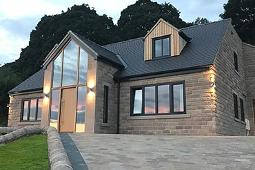 New-build house with solid oak and aluminium/oak windows & doors