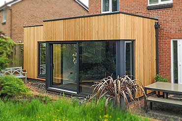 Internorm Sliding Doors on timber-clad extension