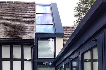 Internorm windows and Solarlux bifold doors in an old School House