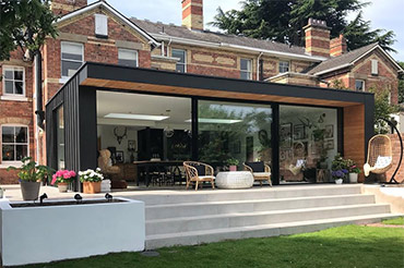 Solarlux Cero 2 Glass Sliding Doors on a contemporary Flat-roof extension